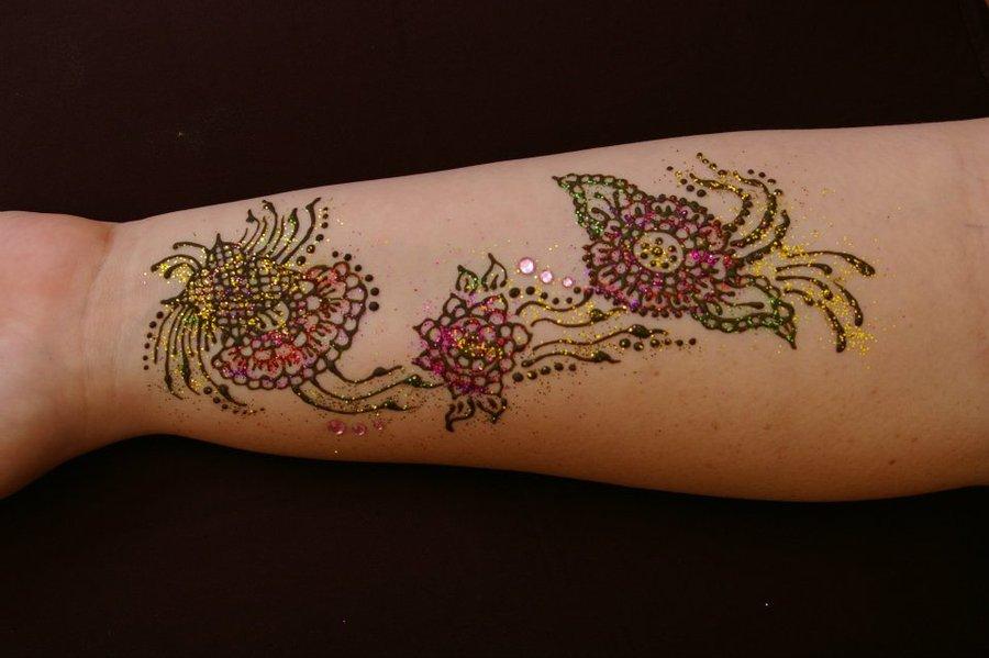 Drying flower henna tattoo with glitter