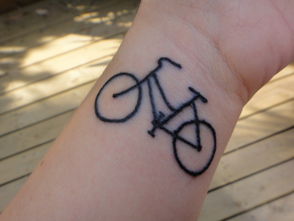 The girl with the bicycle tattoo