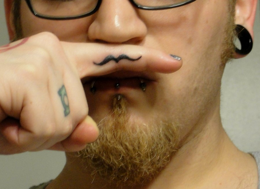 funny tattoo on finger 13