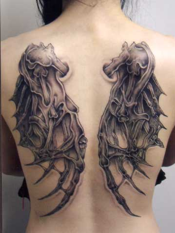gothic dragon wings tattoo on back