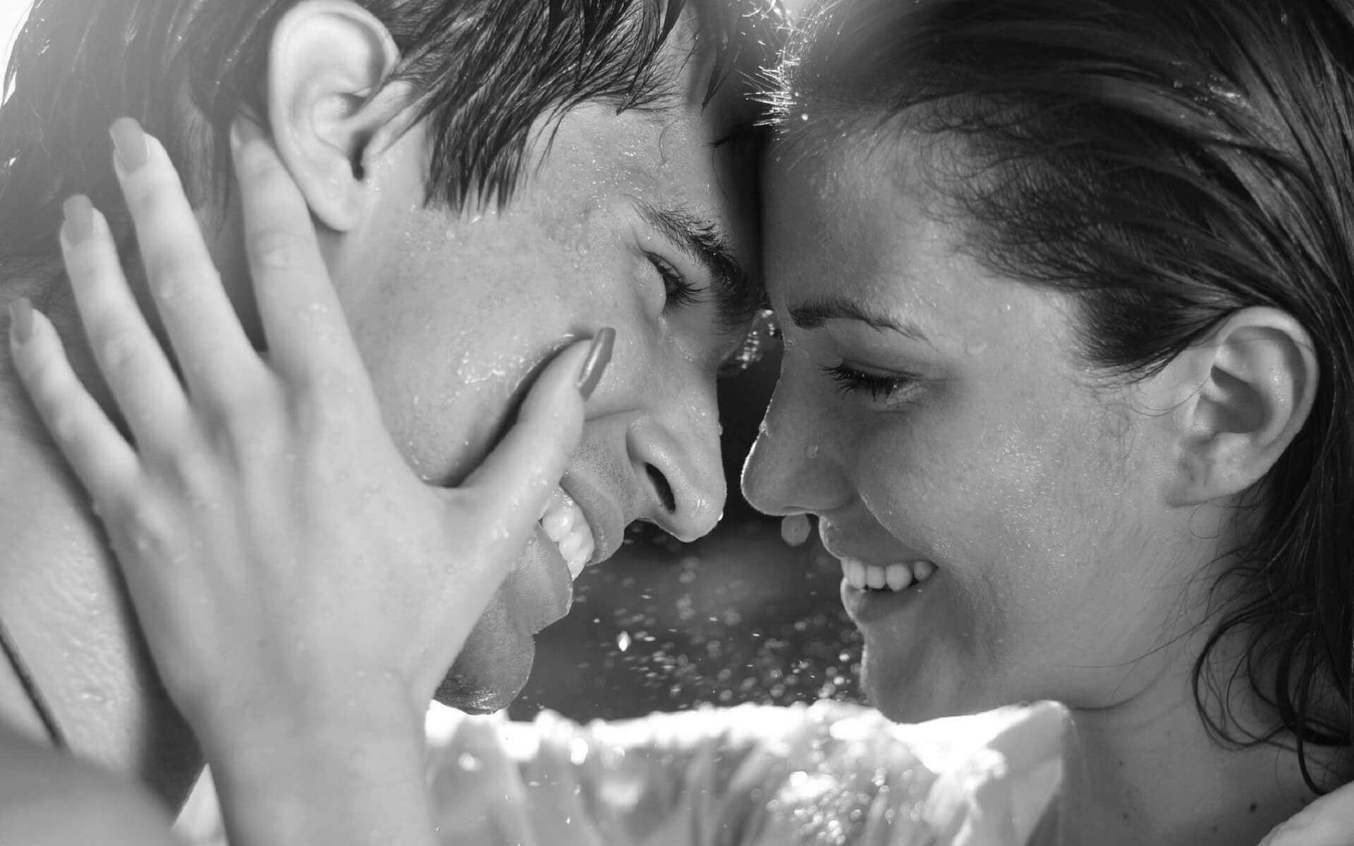 happy couples black and white picture in rain
