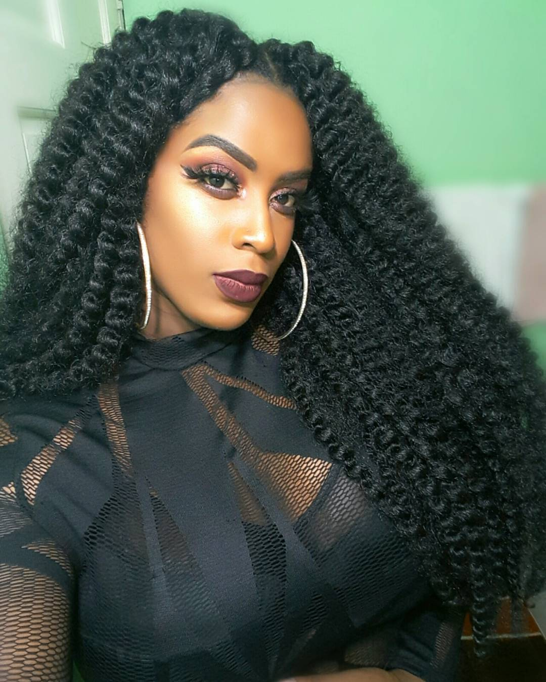 Long center-parted crochet braid hairstyle