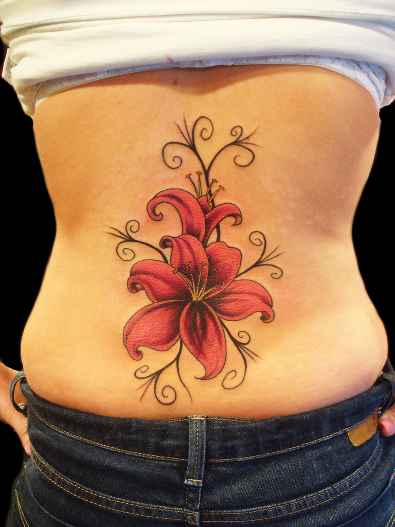 Red Lily fabulous flower lower back tattoo
