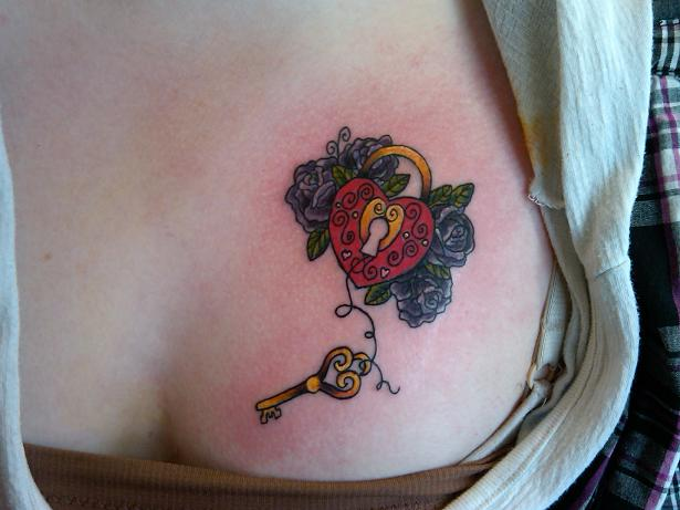 colorful heart locker flowers chest tattoo