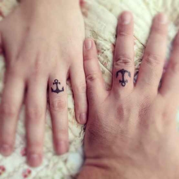 finger ring anchor tattoos couples