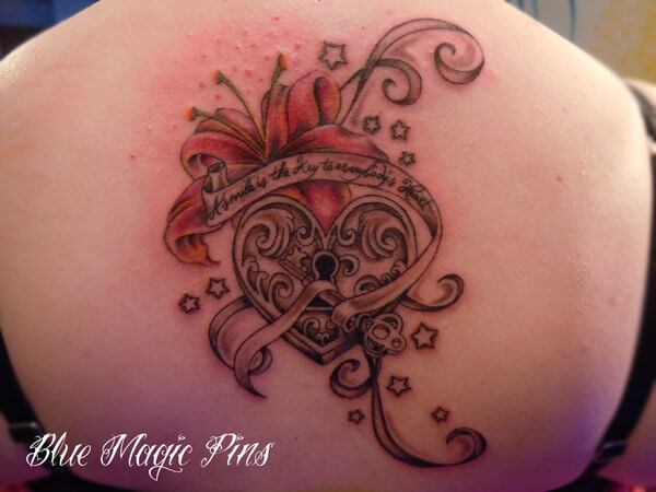 heart locker quote key and lilly flower back tattoo