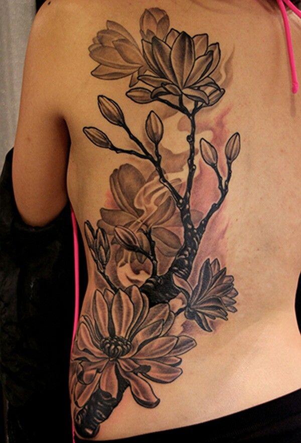 amazing innovative blossom flower black and white tattoo on back