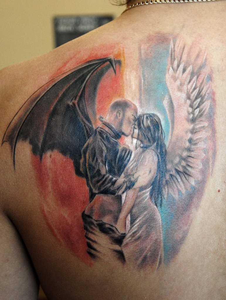 Amazing kissing angel and demon tattoo on shoulder