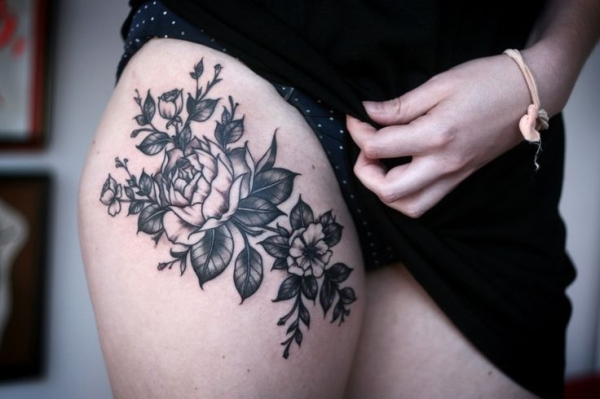 appealing black and white thigh flower tattoo