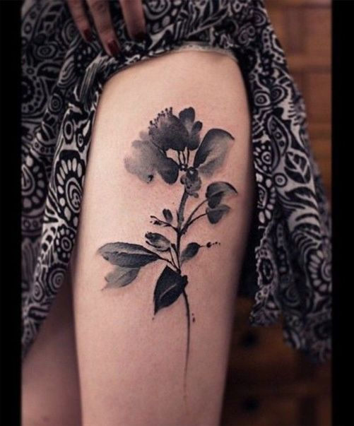black and white watercolor rose flower tattoo design on thigh