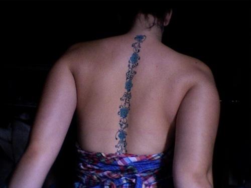 Blue Flowers Spine tattoo design