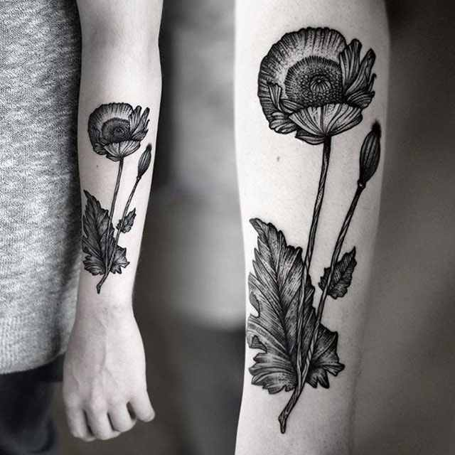 bold black and white poppy flower tattoo design for arm