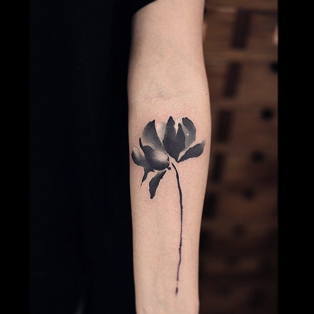 creativity wrapped with liveliness flower black and white tattoo on forearm