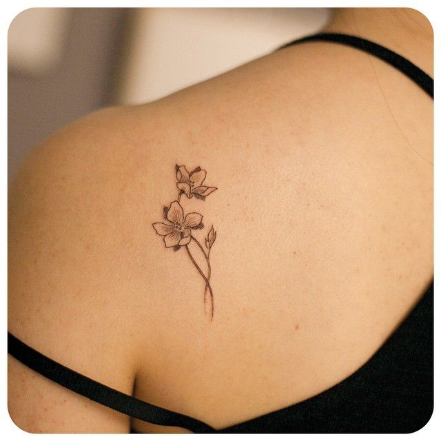 divine nature with intricate black and white flower tattoo pattern on back