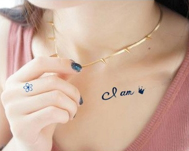 I am queen letters tattoo on collarbone