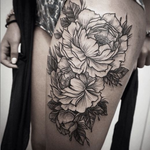 rough-sided black and white flower tattoo design for thigh