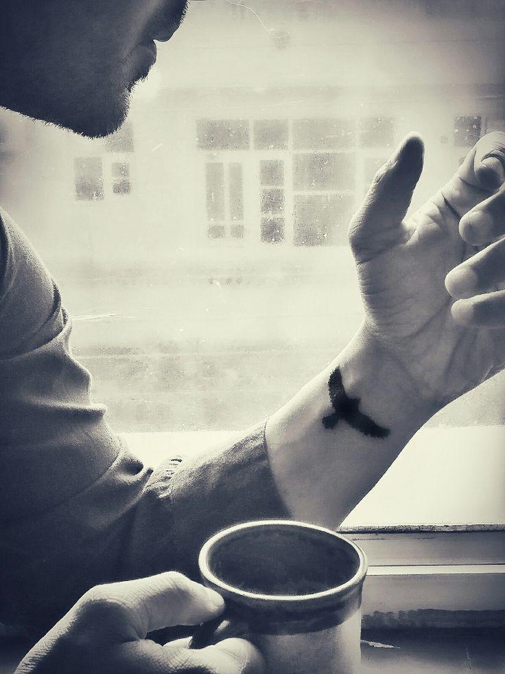 raven wrist tattoo