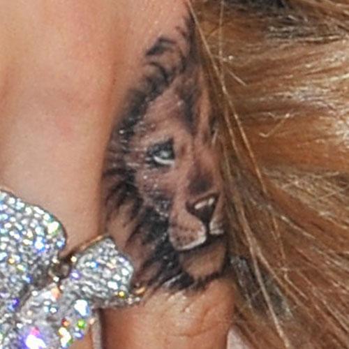 cara delevingne lion tattoo