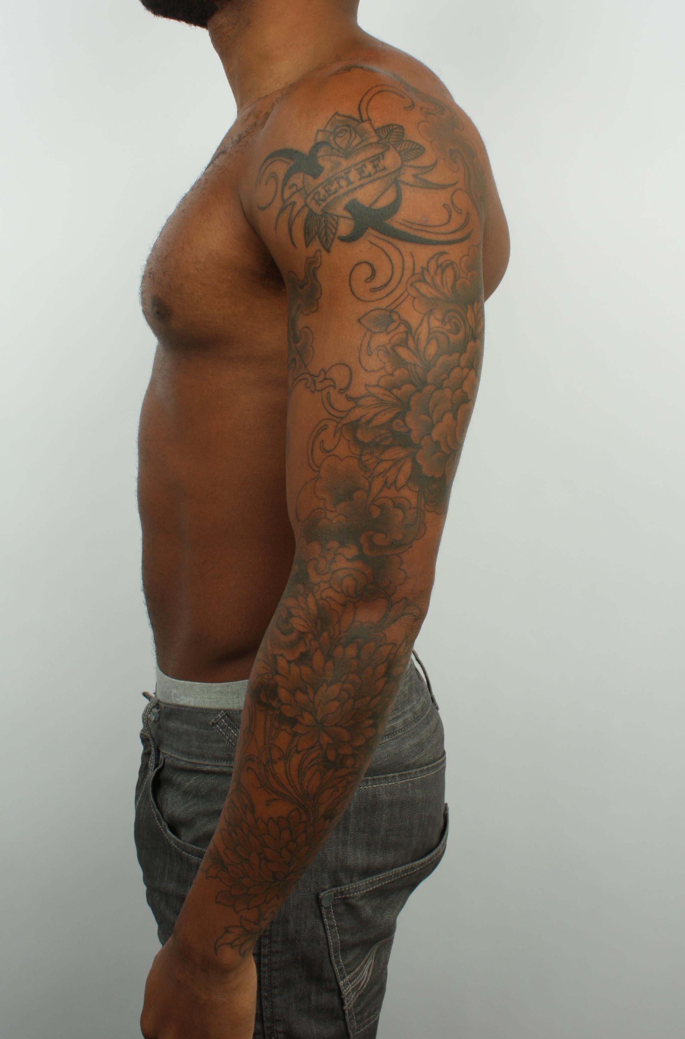 floral heart arm tattoo