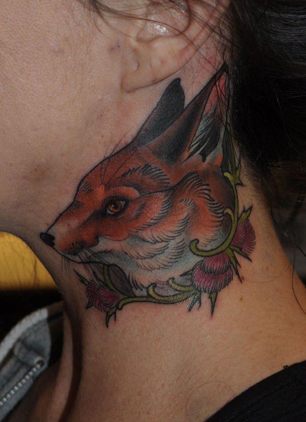 small head fox tattoo on girls neck