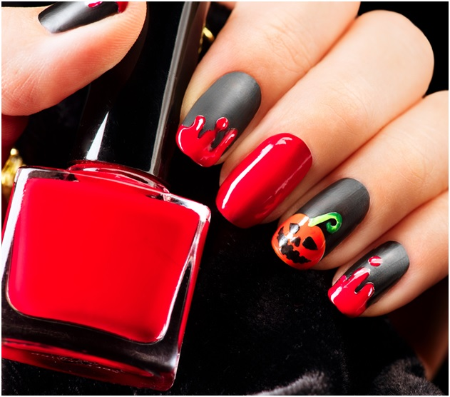 Blood drips pumpkin on black matte nail polish Halloween nails