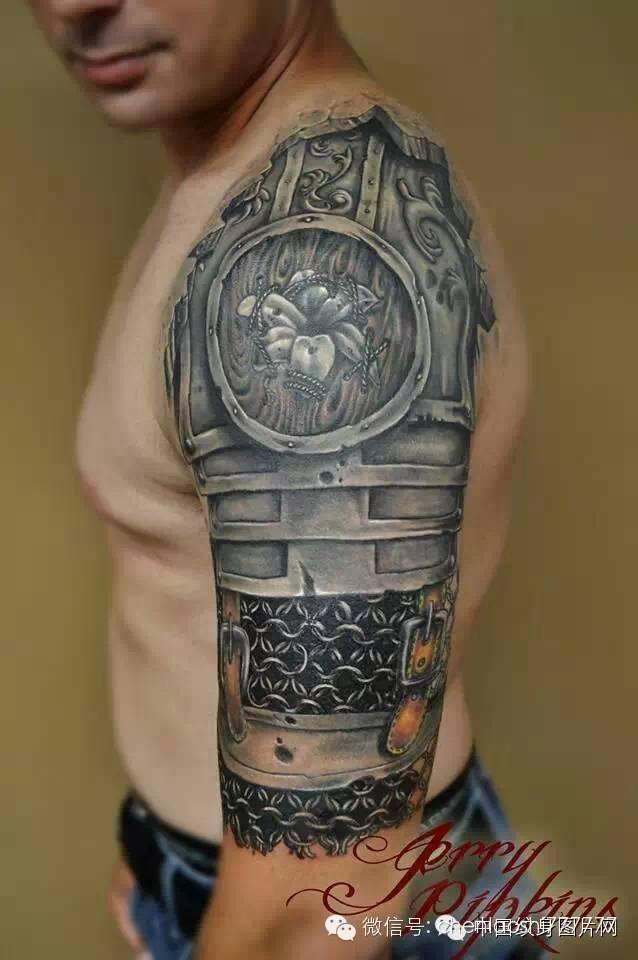 Grey Medieval Armor Tattoo On Half Sleeve