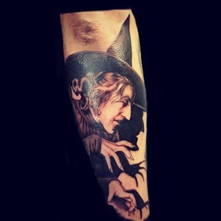 witch portrait tattoo on sleeve