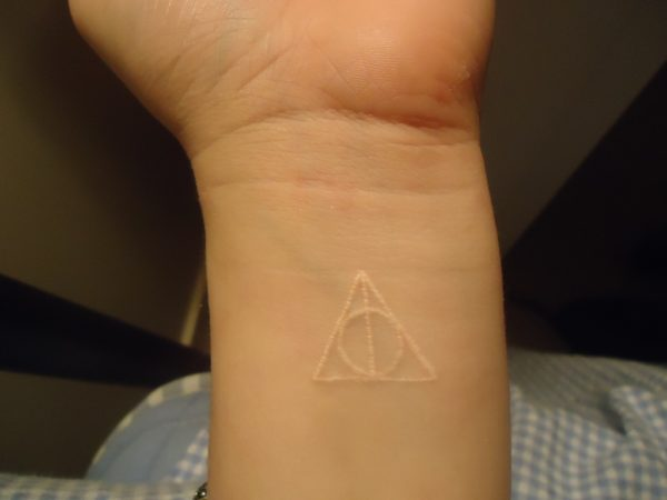 Deathly Hallows white ink tattoo