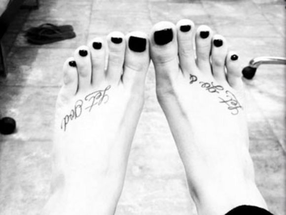 Demi Lovato Let Go and Let God Tattoo on feet