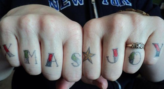 Word Xmas Joy Christmas tattoo on Fingers