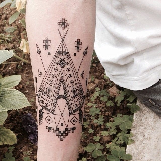 hipster native american tattoo on arm