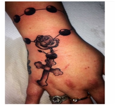 rosary tattoo on wrist