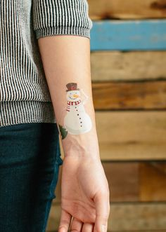snowman tattoo on arm