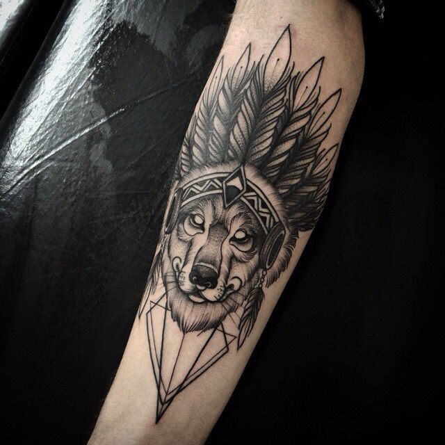 traditional tribal wolf tattoo on arm
