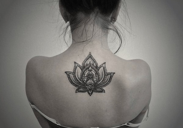 buddhist lotus flower tattoo on back