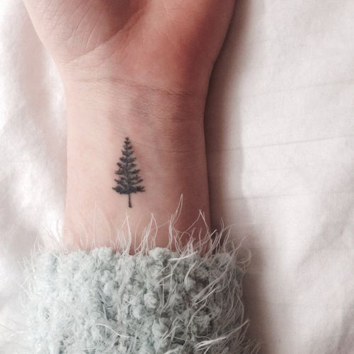 cute pine tree wrist tattoo