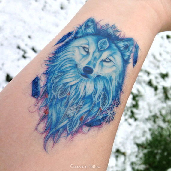 winter wolf tattoo on forearm