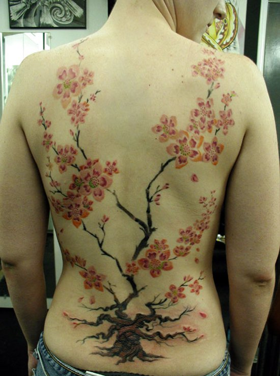 Flowers and Tree of life tattoos