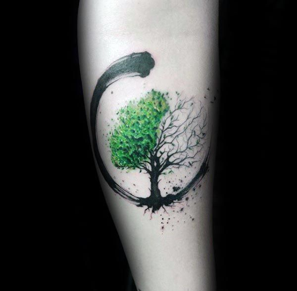 Half green and Half dry tree of life tattoo