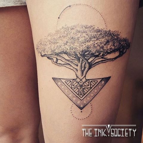 Mayan tree of life tattoo on thigh