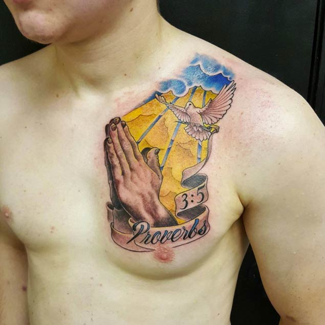 praying hands tattoo on chest