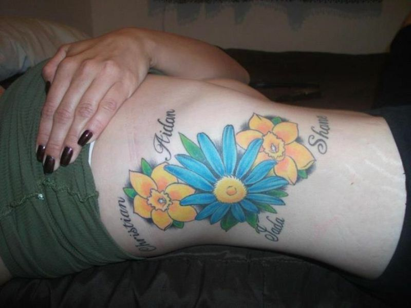 birth flowers daffodil and aster tattoo on side ribs