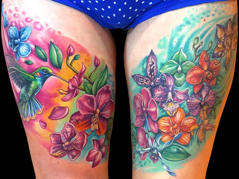 colorful flowers and hummingbird tattoos on thighs