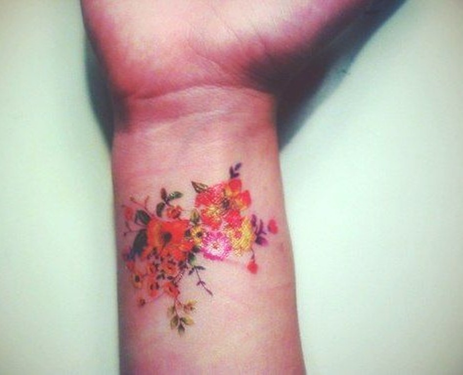 colorful flowers tattoo on wrist