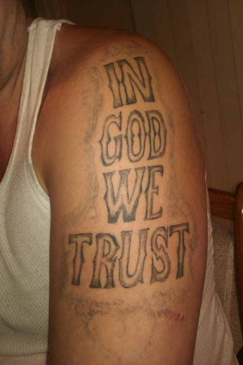 in god we trust tattoo on shoulder