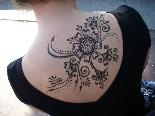 temporary tribal flower henna tattoo on back