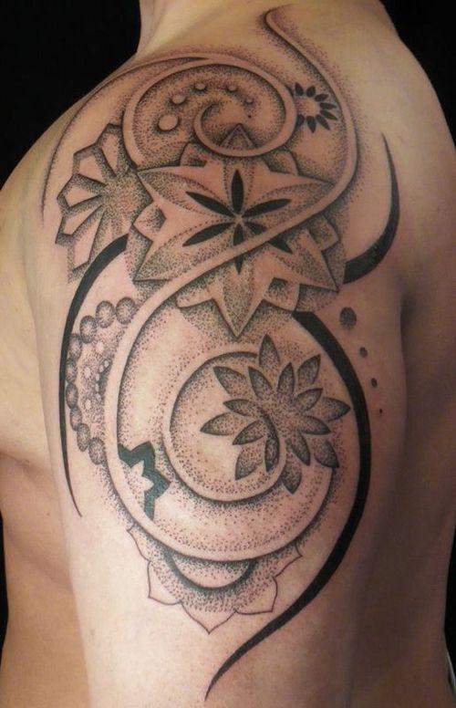 tribal floral pattern tattoo on shoulder