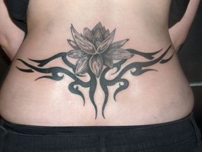 tribal lotus tattoo on lower back