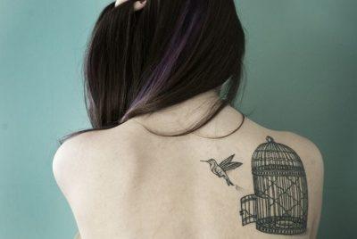 bird cage tattoo on back shoulder blade for women