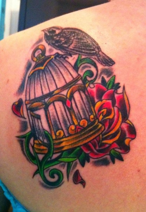 bird cage tattoo on back shoulder for women